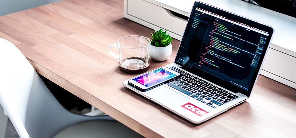 Designer's desk with coding tool open